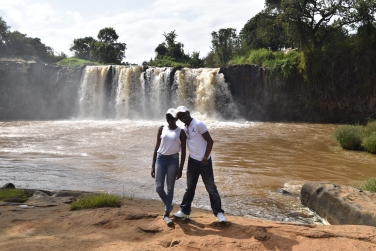 My dad and I. Behind us is the Sagana Waterfall.